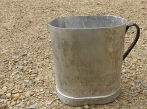 metal jug on gravel