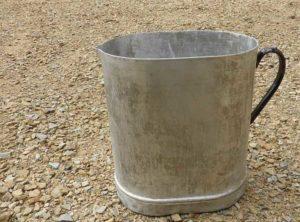 metal jug on gravel