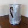 metal jug showing handle